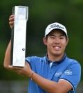 South Korean golfer An Byeong-hun celebrates his win at the BMW Championship. (Adam Davy/PA via AP)
