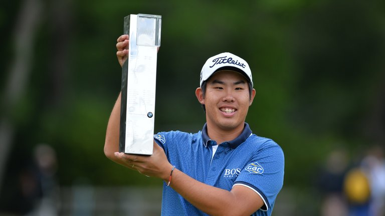 South Korean golfer An Byeong-hun celebrates his win at the BMW Championship. (Adam Davy/PA via AP)
