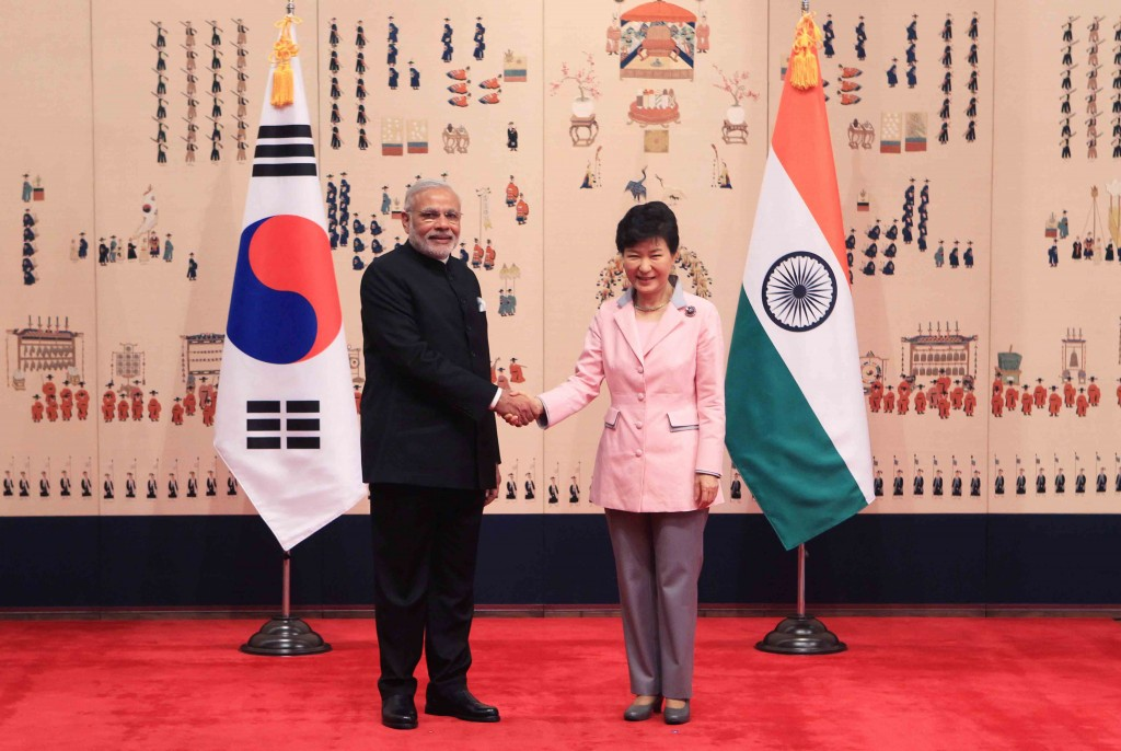 Indian Prime Minister Narendra Modi, left,  shakes hands with South Korean President Park Geun-hye prior to their meeting at the presidential Blue House Monday, May 18, 2015 in Seoul, South Korea. (Chung Sung-Jun/Pool Photo via AP)