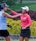 Minjee Lee, of Australia, right, hugs fellow golfer, Lexi Thompson, left, on the 18th hole of the rain delayed Kingsmill Championship LPGA golf tournament at the Kingsmill Golf Club in Williamsburg, Va., Monday, May 18, 2015. Lee won the tournament. (AP Photo/Steve Helber)