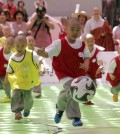 Shaven-headed children who entered temples to have an experience of monks' life for weeks, play Dongjasung (little monk) soccer at Jogye temple in Seoul, South Korea, Thursday, May 14, 2015. The Dongjasung soccer match is one of the events to celebrate Buddha's upcoming 2,559th birthday on May 25 and to publicize Korean Buddhism. (AP Photo/Lee Jin-man)