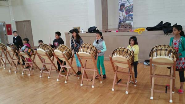 Students follow the instruction of teacher Lee Young-sook during the first lesson of Salinas' new Korean culture education program.