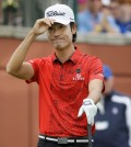 Kevin Na acknowledges the gallery before his tee shot on the first hole during the final round of the Colonial golf tournament, Sunday, May 24, 2015, in Fort Worth, Texas. (AP Photo/LM Otero)