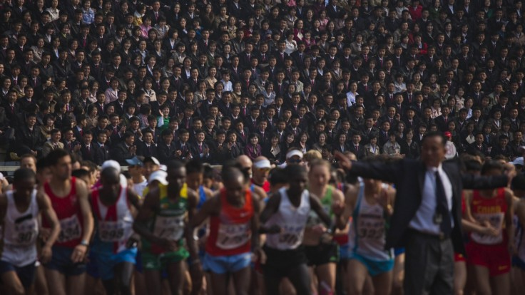 North Korean spectators watch from the stands of Kim Il-sung Stadium as runners line up at the start of the Mangyongdae Prize International Marathon in Pyongyang, North Korea. (AP Photo/David Guttenfelder)