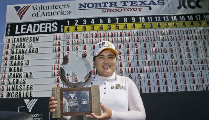 Park Inbee, of South Korea, posses with the champion's trophy after winning the LPGA North Texas Shootout golf tournament, Sunday, May 3, 2015, in Irving, Texas. (AP Photo/LM Otero)