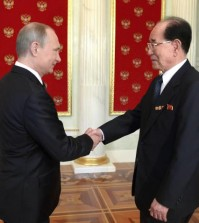 Russian President Vladimir Putin (L) and North Korean Chairman of the Presidium of the Supreme People's Assembly Kim Yong-nam shake hands at their meeting in the Kremlin in Moscow, Russia, on May 9, 2015. (Yonhap file photo)