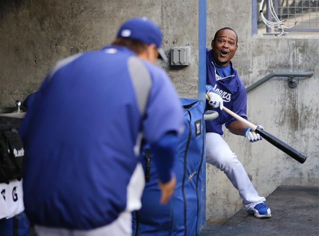 Ryu Hyun-jin and Juan Uribe of the Los Angeles Dodgers (AP Photo/Gene J. Puskar)