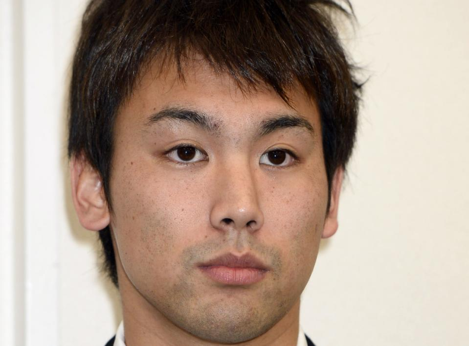 Japanese swimmer Naoya Tomita, who was suspended for stealing a camera at the Asian Games, attends a news conference in Nagaya, central Japan, Thursday, Nov. 6, 2014. Tomita has denied the allegations, claiming someone placed the camera in his gym bag. He initially admitted to stealing a camera left poolside by a South Korean reporter on Sept. 25 at the games in Incheon, South Korea. (AP Photo/Kyodo News)