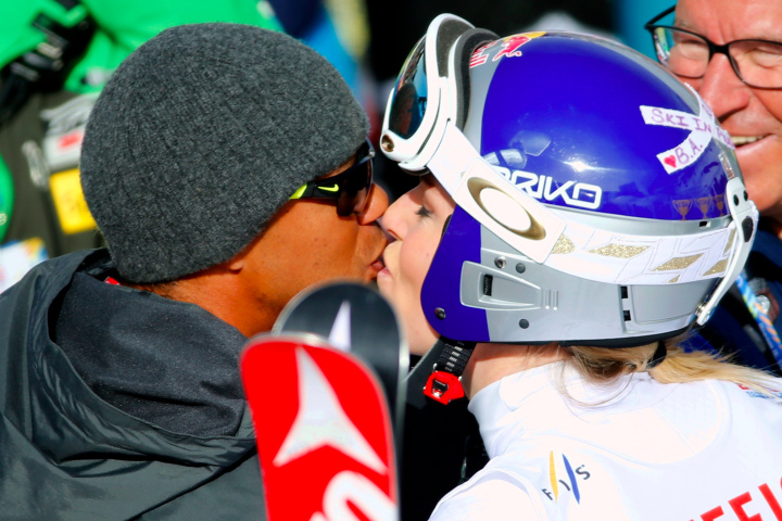Tiger Woods kisses Lindsey Vonn at the alpine skiing world championships in Colorado. (AP)