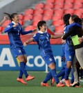 Thailand players run to the sidelines to celebrate after a score against Ivory Coast during the first half of a FIFA Women's World Cup soccer match in Ottawa, Ontario, Canada, on Thursday, June 11, 2015. (Sean Kilpatrick/The Canadian Press via AP)