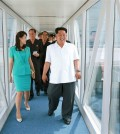 North Korean leader Kim Jong-un tours the new Pyongyang airport terminals with his wife Ri Sol-ju. (KCNA/Yonhap)