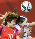 Costa Rica's Wendy Acosta, right, challenges South Korea's JI Soyun during the second half of a FIFA Women's World Cup soccer match Saturday, June 13, 2015, in Montreal, Canada. (Graham Hughes/The Canadian Press via AP)