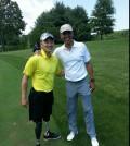 Jason Pak, left, and President Barack Obama at TPC Potomac golf club Saturday.
