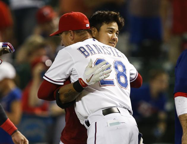Rangers outfielder Choo Shin-soo and manager Jeff Banister have gotten along in the past. What's bugging him now? (AP Photo/Jim Cowsert)