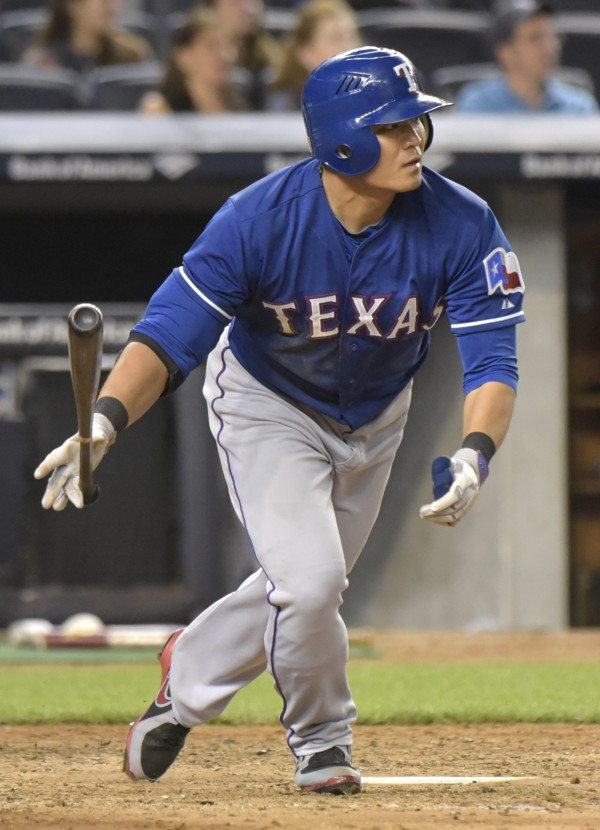 Texas Rangers' Shin-Soo Choo hits an RBI-double during the seventh inning of a baseball game against the New York Yankees Sunday, May 24, 2015, at Yankee Stadium in New York. (AP Photo/Bill Kostroun)