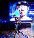 "Choi ""PoLt"" Seong-hun walks off stage after an e-sports championship match. (AP Photo/David Goldman)"