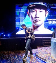"Choi ""PoLt"" Seong-hun walks off stage after an e-sports championship match. (AP Photo/David Goldman)"
