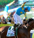 Victor Espinoza reacts after crossing the finish line with American Pharoah (5) to win the 147th running of the Belmont Stakes horse race at Belmont Park, Saturday, June 6, 2015, in Elmont, N.Y. American Pharoah is the first horse to win the Triple Crown since Affirmed won it in 1978.(AP Photo/Bill Kostroun)