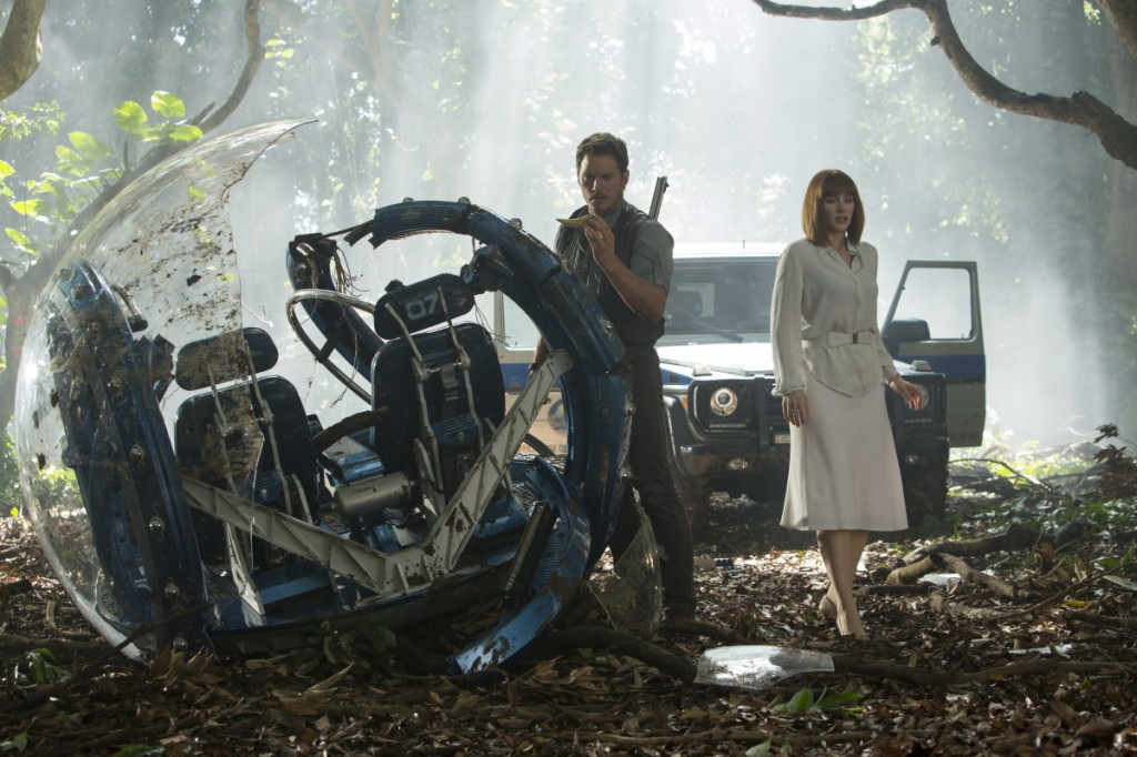 "This photo provided by Universal Pictures shows, Chris Pratt, left, and Bryce Dallas Howard in a scene from the film, ""Jurassic World,"" directed by Colin Trevorrow, in the next installment of Steven Spielberg's groundbreaking ""Jurassic Park"" series. The 3D movie releases in theaters by Universal Pictures on June 12, 2015. (Chuck Zlotnick/Universal Pictures via AP)"