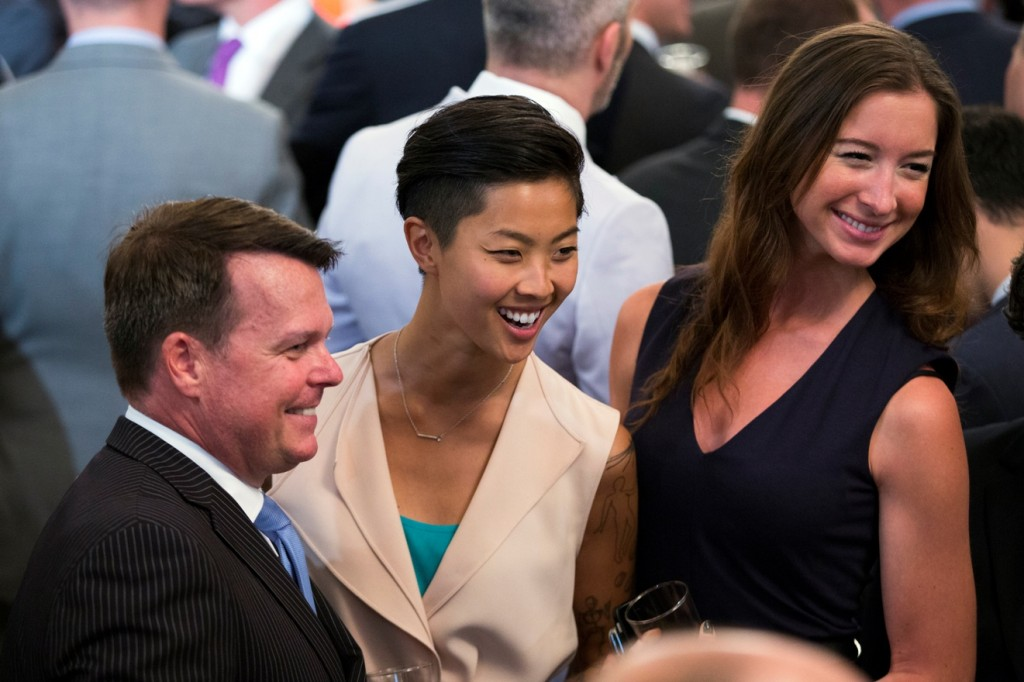 Top Chef winner Kristen Kish, center, and her girlfriend Jacqueline Westbrook, right, pose for photos during a reception to celebrate LGBT Pride Month in the East Room of the White House, on Wednesday, June 24, 2015, in Washington. (AP Photo/Evan Vucci)