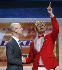 D'Angelo Russell, right, gestures upward as he is greeted by NBA Commissioner Adam Silver after the Los Angeles Lakers selected Russell with the second pick in the NBA basketball draft, Thursday, June 25, 2015, in New York. (AP Photo/Kathy Willens)