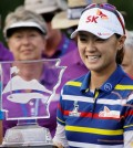 Na Yeon Choi, of South Korea, holds trophy after winning the NW Arkansas Championship LPGA golf tournament at Pinnacle Country Club in Rogers, Ark., Sunday, June 28, 2015. (AP Photo/Danny Johnston)