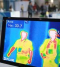 "A thermal camera monitor shows the body temperature of visitors during the Job Fairs in Seoul, South Korea Friday, June 5, 2015. Sales of surgical masks surge amid fears of the deadly, poorly understood virus. Airlines announce ""intensified sanitizing operations."" More than 1,100 schools close and 1,600 people - and 17 camels in zoos - are quarantined. The current frenzy in South Korea over MERS brings to mind the other menacing diseases to hit Asia over the last decade - SARS, which killed hundreds, and bird flu. (Yonhap)"