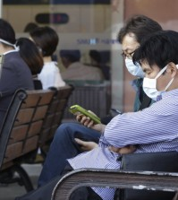 South Koreans wearing masks against the possible Middle East Respiratory Syndrome virus sit at the emergency room at Seoul National University Hospital in Seoul, South Korea, Monday, June 1, 2015. More than 680 people in South Korea are isolated after having contact with patients infected with a virus that has killed hundreds of people in the Middle East, health officials said Monday.(AP Photo/Ahn Young-joon)