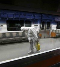 A worker wearing protective gear sprays antiseptic solution in a subway car amid rising public concerns over the spread of MERS, Middle East Respiratory Syndrome, virus at the subway car depot in Goyang, South Korea, Tuesday, June 9, 2015. South Korea believes its MERS virus outbreak may have peaked, and experts say the next several days will be critical to determining whether the government's belated efforts have successfully stymied a disease that has killed seven people and infected nearly 100 in the country. (AP Photo/Lee Jin-man)