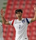 Son Heung-min of South Korea celebrates after scoring a goal against Myanmar in a World Cup qualifying match in Bangkok on June 16, 2015. (Yonhap)