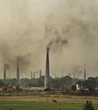 Smoke rises from chimneys of brick kilns on the outskirts of New Delhi, India, Tuesday, June 16, 2015. Never mind lowering the rate of death from air pollution in India and China. Just keeping those rates steady will demand urgent action to clear the skies, according to a new report published Tuesday. (AP Photo/Altaf Qadri)