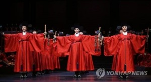 """Members of national troupes perform royal ancestral ritual music during a rehearsal held at a theater of the National Gugak Center in Seoul on June 11, 2015. The rehearsal was opened to media ahead of the performance of the Jongmyo Jeryeak at the Theatre National de Chaillot in Paris on Sept. 18-19 as the opener of the """"Years 2015-2016 of Korea-France Bilateral Exchanges"""" to mark the 130th anniversary of diplomatic ties between the two countries. (Yonhap)"""