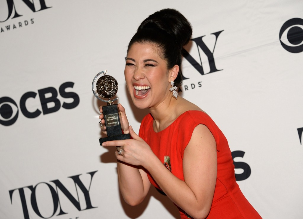 """Ruthie Ann Miles poses with the award for best performance by an actress in a featured role in a musical for """"The King & I"""" in the press room at the 69th annual Tony Awards at Radio City Music Hall on Sunday, June 7, 2015, in New York. (Photo by Evan Agostini/Invision/AP)"""