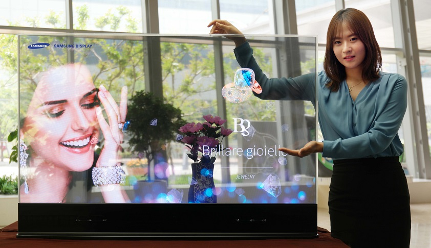 A Samsung Display employee presents the 55-inch transparent display, Wednesday. (Courtesy of Samsung Display)
