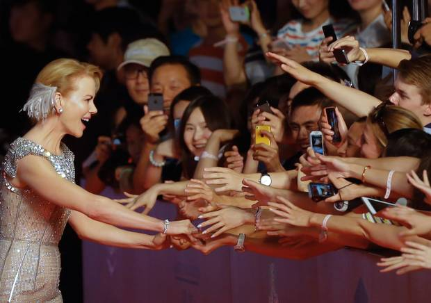 Nicole Kidman, left, shakes hands of fans as she attends the opening ceremony of the 17th Shanghai International Film Festival in Shanghai, China. South Korean participants were told not to come to the 2015 event due to concerns over the MERS virus.  (AP Photo)
