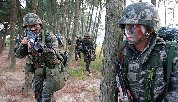 South Korean Marines move after they landed on the beach during a landing exercise in Taean, western South Korea, Monday, June 29, 2015. South Korean Navy and Marine held a joint landing drill on the west coast on Monday improving their military readiness to protect the Korean Peninsula.(AP Photo/Ahn Young-joon)