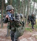 A South Korean soldier points his weapon at the camera during a military drill. (Yonhap)