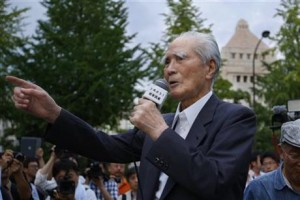 Japan's former Prime Minister Tomiichi Murayama speaks during a rally in front of the National Diet building in Tokyo, Thursday, July 23, 2015. Protesters gathered outside parliament, opposing a set of controversial bills intended to expand Japan's defense role at home and internationally. (AP Photo/Shizuo Kambayashi)