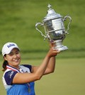 South Korea's In Gee Chun holds up the championship trophy after winning the U.S. Women's Open golf tournament at Lancaster Country Club, Sunday, July 12, 2015 in Lancaster, Pa. Chun won by one stroke over second place finisher Amy Yang.(AP Photo/Gene J. Puskar)