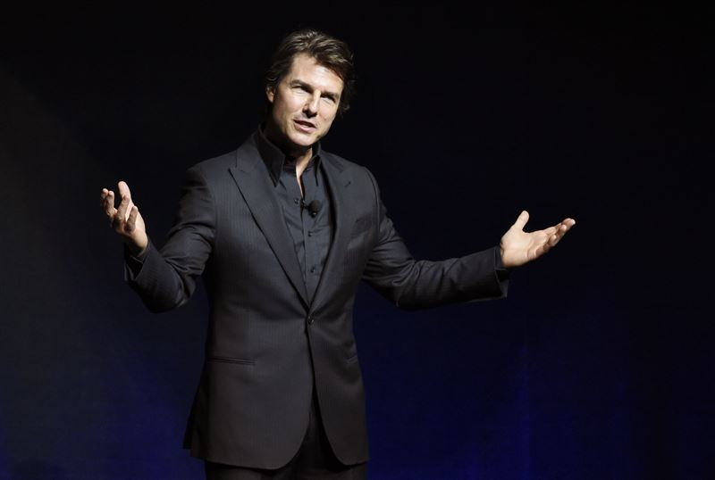 "Tom Cruise, star of the upcoming film ""Mission: Impossible: Rogue Nation,"" addresses the audience during a surprise appearance at the Paramount Pictures presentation at CinemaCon 2015 at Caesars Palace on Tuesday, April 21, 2015, in Las Vegas. (Photo by Chris Pizzello/Invision/AP)"