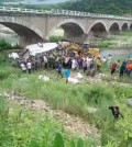 A photo posted on blogging site Sina Weibo shows the scene of a bus accident in the northeastern city of Jian, China, on July 1, which killed 10 South Koreans. The bus veered off the bridge into the river below. (Yonhap)