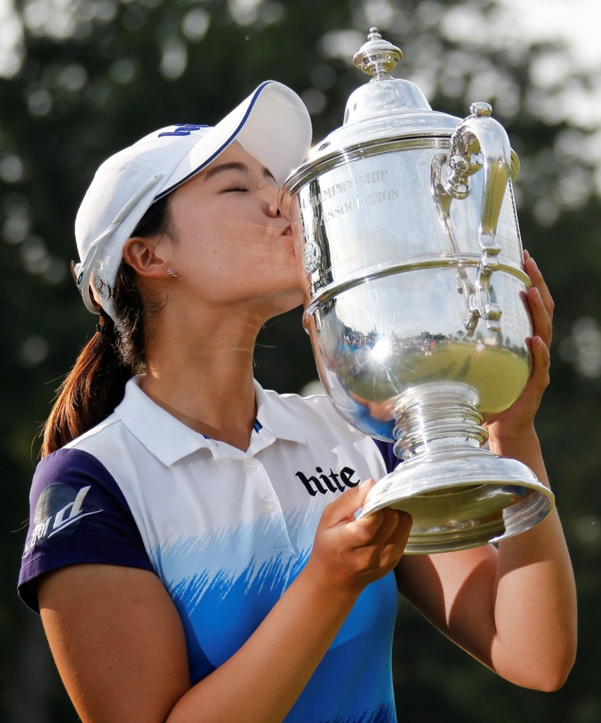 South Korea's Chun In Gee kisses the championship trophy after winning the U.S. Women's Open golf tournament at Lancaster Country Club, Sunday, July 12, 2015 in Lancaster, Pa. Chun won by one stroke over second place finisher Amy Yang. (AP Photo/Gene J. Puskar)