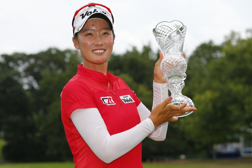 Chella Choi, of South Korea, holds her trophy after winning the Marathon Classic golf tournament on the first playoff hole at Highland Meadows Golf Club in Sylvania, Ohio, Sunday, July 19, 2015. (Yonhap/AP Photo/Rick Osentoski)