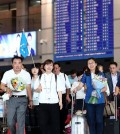 A group of Chinese tourists leaves Incheon airport, west of Seoul, on July 13, 2015, as the group came to South Korea on a familiarization tour program organized by Korean Air Lines Co. South Korean airlines are ramping up efforts to lure Chinese tourists as the spread of Middle East Respiratory Syndrome (MERS) is recently showing signs of slowing down. (Yonhap)