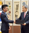 Incoming Harvard University freshman Albert Choi gets congratulated by the Ambassador of the Republic of Korea in Washington D.C. (Courtesy of Albert Choi/South Korean Embassy)