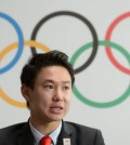 "Denis Ten, from Kazakhstan, Sochi 2014 Bronze medalist in the men's singles figure skating, speaks at a news conference during the 2022 Winter Olympics Candidate City Briefing for IOC Members at the Olympic Museum, in Lausanne, Switzerland, Tuesday, June 9, 2015. With the vote less than two months away, leaders of the Almaty and Beijing bids made presentations at a ""technical briefing"" at the Olympic Museum in Lausanne. The meeting was attended by 85 of the International Olympic Committee's 101 members. (Jean-Christophe Bott/Keystone via AP)"