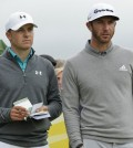 United States' Jordan Spieth, left, and United States' Dustin Johnson speak before playing from the 15th tee during the first round of the British Open Golf Championship at the Old Course, St. Andrews, Scotland, Thursday, July 16, 2015. (AP Photo/David J. Phillip)