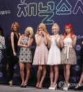 "Members of K-pop group Girls' Generation pose to demonstrate the theme of their segments in ""Channel Girls' Generation,"" a new reality show launching on July 21, 2015, in Seoul. (Yonhap)"