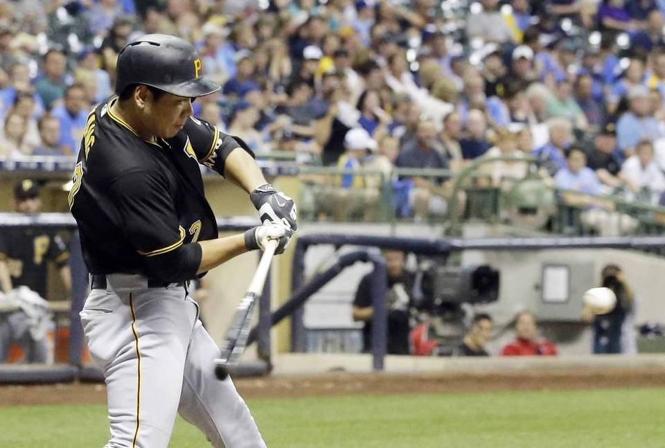Pittsburgh Pirates' Kang Jung-ho hits a home run during the seventh inning of a baseball game against the Milwaukee Brewers Friday, July 17, 2015, in Milwaukee. (AP Photo/Morry Gash)