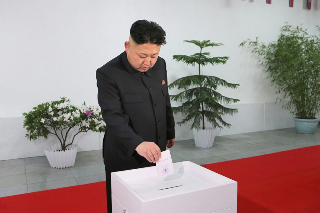 A picture released by the North Korea Central News Agency (KCNA) shows North Korean leader Kim Jong-un casting a ballot at a polling station. (Yonhap/KCNA)